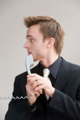 bigstock-businessman-nervouse-phone